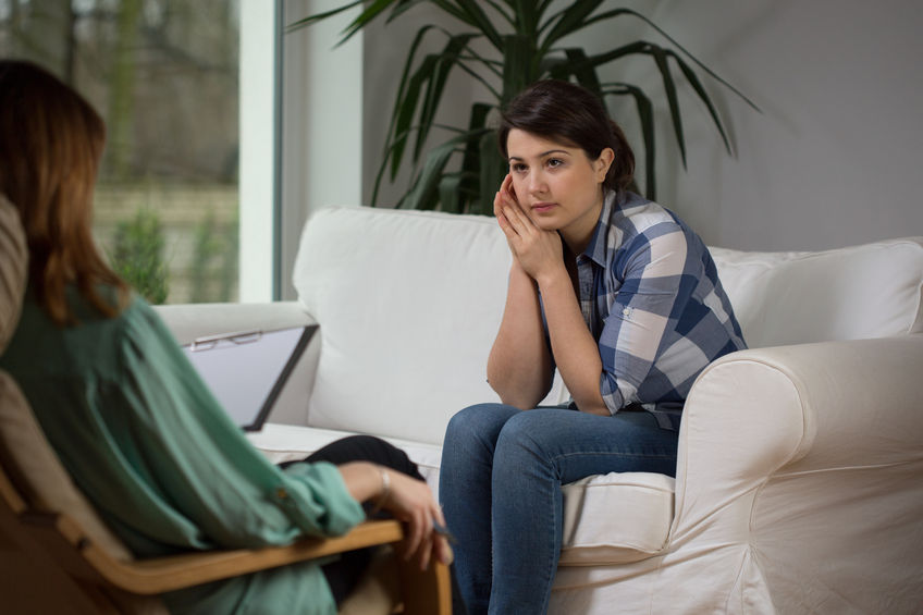 Client talking to her therapist about overcoming anxiety.