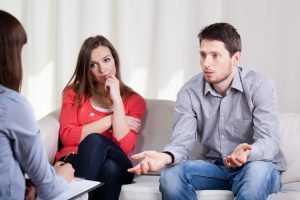Couple dealing with challenges in couples counseling or relationship therapy.